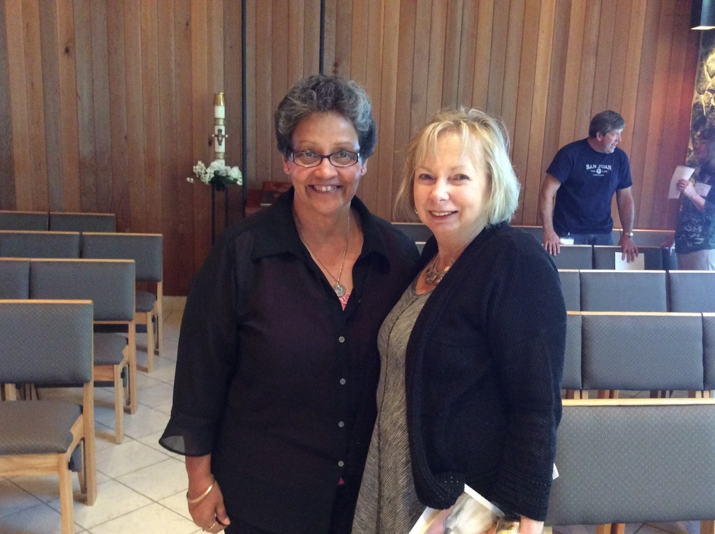 Minerva Alicea and Betty Shaw share a moment in the San Pedro chapel. (Image credit: Ellen Kalenberg)
